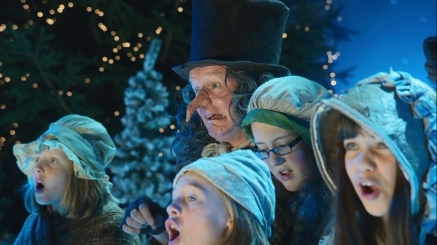 When the hell did they switch their act from singing elves to a Dickensian nightmare!?