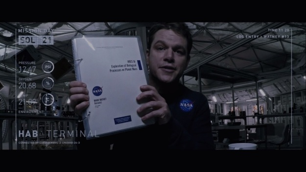 """You see this?  See how convincingly I can hold this sciency notebook?  Now you know why I get the big bucks!"""