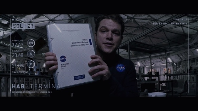 """""""You see this? See how convincingly I can hold this sciency notebook? Now you know why I get the big bucks!"""""""